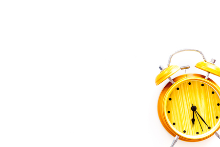 Alarm clock for for waking up on white background top view copy space