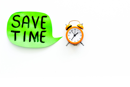 Time-management. Save time hand lettering in cloud near alarm clock on white background top view copy space