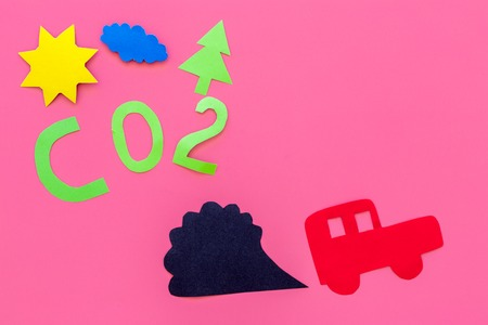 Cars emitting carbon dioxide. Pollution concept. harm the environment. Car and smoke cutout on pink background top view copy space
