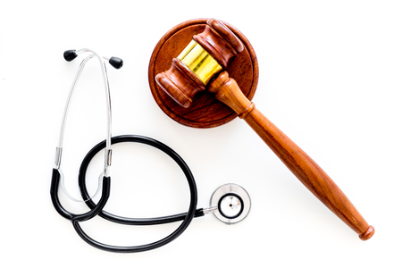 Medical law, health law concept. Gavel and stethoscope on white background top view copy space Stock Photo