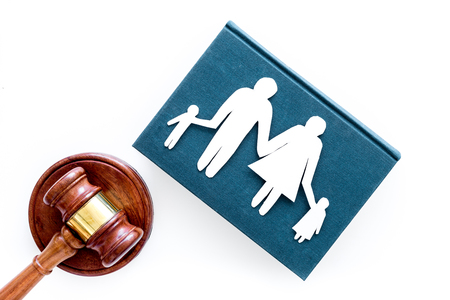 Family law, family right concept. Child-custody concept. Family with children cutout near court gavel on white background top view copy space Foto de archivo - 104261591