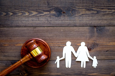 Family law, family right concept. Child-custody concept. Family with children cutout near court gavel on dark wooden background top view copy space Stockfoto - 104261590