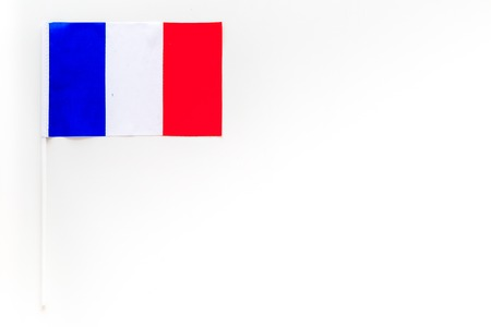 French flag concept. small flag on white background top view copy space Stok Fotoğraf