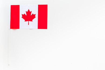 Canadian flag concept. small flag on white background top view copy space