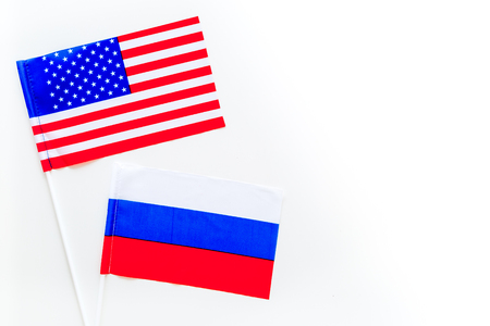 Russia-USA relations. Country cooperation. Russian and American flags on white background top view copy space