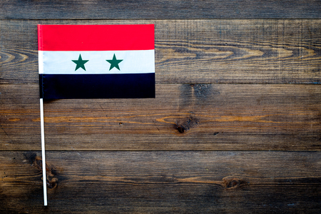 Syrian flag concept. small flag on dark wooden background top view copy space Stockfoto