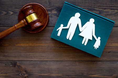 Family law, family right concept. Child-custody concept. Family with children cutout near court gavel on dark wooden background top view copy space Stockfoto - 104352158
