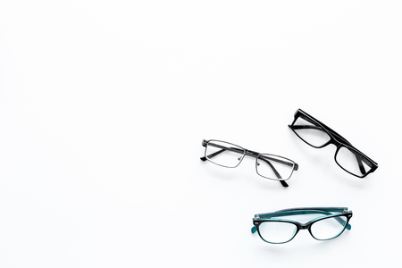 Glasses concept. Set of glasses with different eyeglass frame and transparent lenses on white background top view copy space