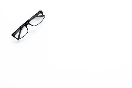 One glasses with transparent lenses on white background top view copy space Reklamní fotografie - 104352234
