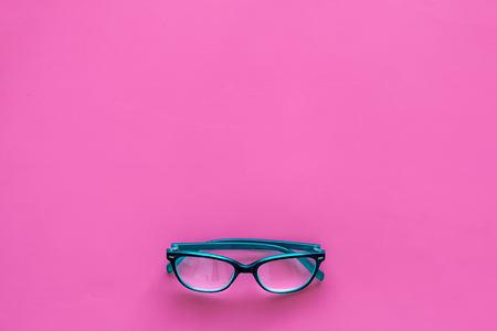 One glasses with transparent lenses on pink background top view copy space Reklamní fotografie - 104352240