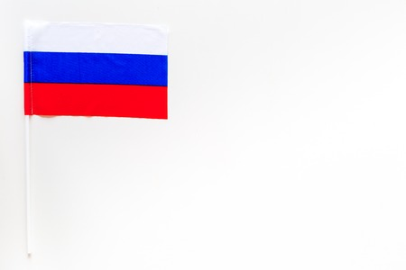 Russian flag concept. Small flag on white background top view copy space