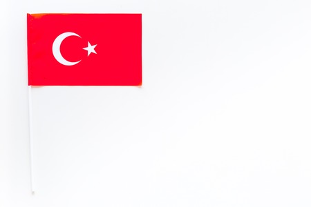 Turkish flag concept. small flag on white background top view copy space