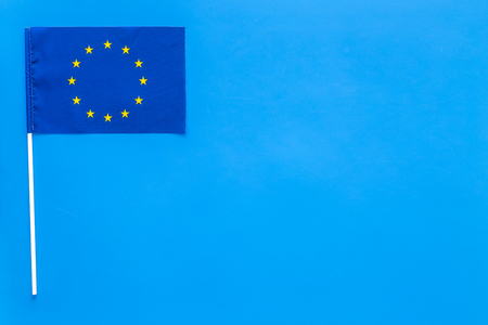 Flag of Europe concept. small flag on blue background top view copy space Reklamní fotografie - 104352315