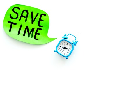Time-management. Save time hand letterng in cloud near alarm clock on white background top view.
