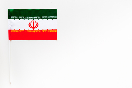 Iranian flag concept. Small flag top view 스톡 콘텐츠