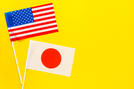 American and Japanese flags top view copy space