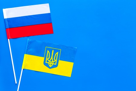 Russian and Ukrainian flags top view copy space 스톡 콘텐츠