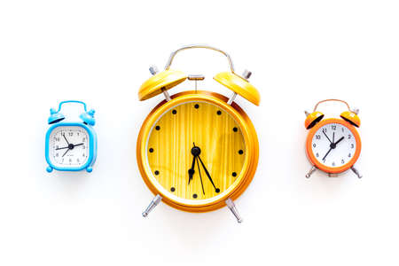 Alarm clock for for waking up on white background top view.
