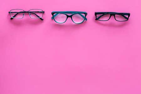 Glasses concept. Set of glasses with different eyeglass frame and transparent lenses on pink background top view. Reklamní fotografie