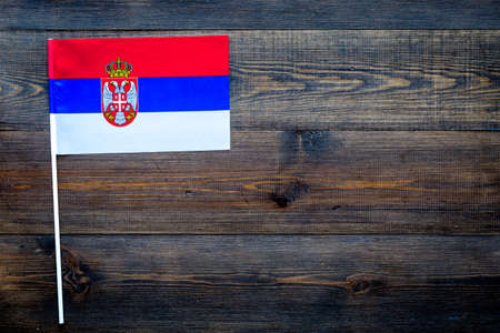 Serbian flag concept. Small flag top view 스톡 콘텐츠