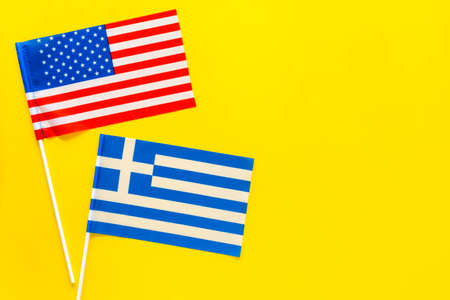 American and Greek flags top view copy space