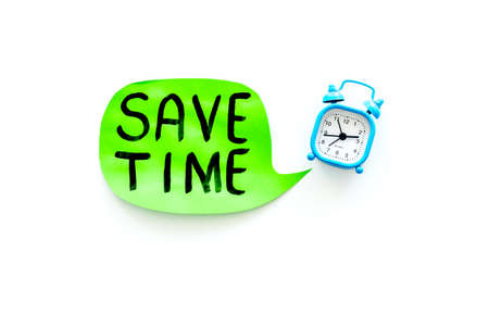 Time-management. Save time hand lettering in cloud near alarm clock on white background top view space for text