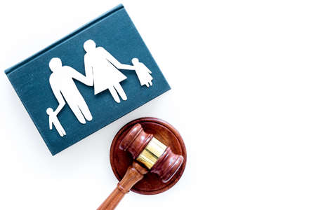 Family law, family right concept. Child-custody concept. Family with children cutout near court gavel on white background top view copy space Foto de archivo - 104544283