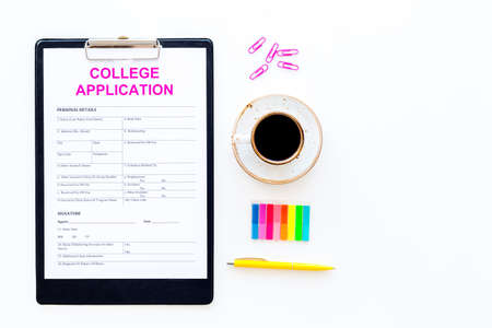 Apply college. Empty college application form near coffee cup and stationery on white background top view space for text
