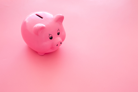 Piggy bank. Moneybox in shape of pig on pink background.