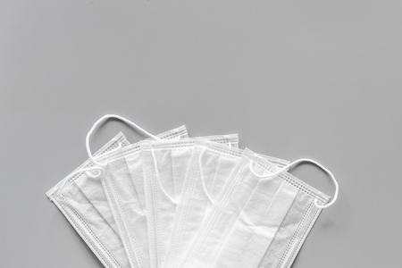 Flu prevention. Medical face masks on grey background top view copy space Stock Photo - 106554349