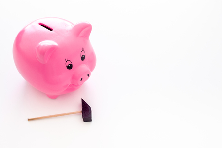 Piggy bank. Moneybox in shape of pig near hammer on white background copy space