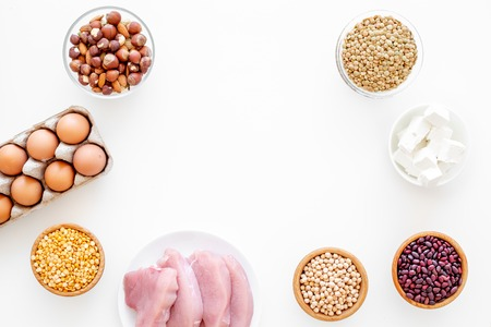 Healthy food. Products rich protein and fiber. Legumes, nuts, low-fat cheese, meet, eggs. Raw beans, chickpeas, lentil, almond hazelnut on white background top view Stock Photo
