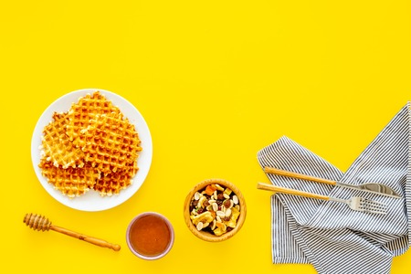 Hot round waffles ready to eat.