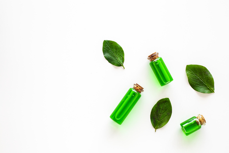 Tea tree essential oil near tea tree leaves on white background top view copy space Stock Photo