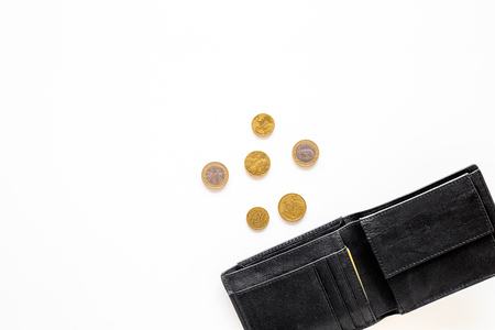 Unemployment concept. Lack of money. Coins fall out of wallet on white background top view. Stok Fotoğraf