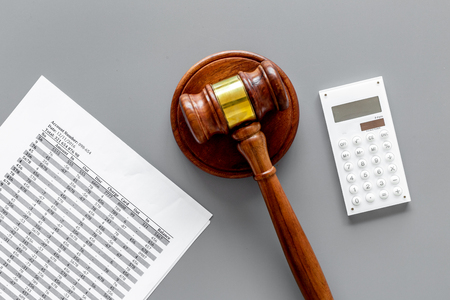 Bankruptcy concept. Judge gavel, documents, calculator on grey background top view Фото со стока