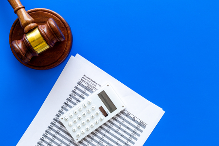 Declare bankruptcy concept. Judge gavel, financial documents, calculator on blue background top view. Stock Photo