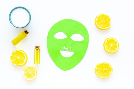 Cosmetics with natural ingredients. Facial mask, cream and lotion based on avocado and lemon essential oil on white background top view.