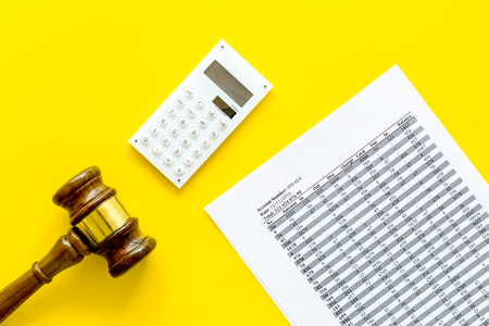 Declare bankruptcy concept. Judge gavel, financial documents, calculator on yellow background top view.
