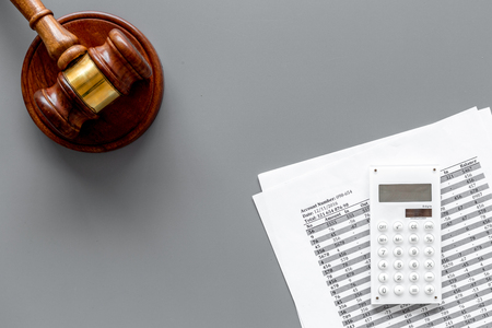 Declare bankruptcy concept. Judge gavel, financial documents, calculator on grey background top view.
