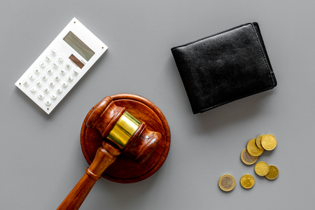 Financial failure, bankruptcy concept. Judge gavel, wallet, coins calculator on grey background Фото со стока