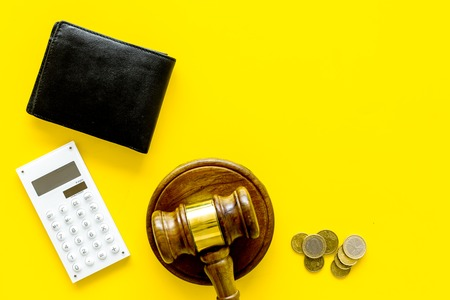Financial failure, bankruptcy concept. Judge gavel, wallet, coins calculator on yellow background Stock Photo