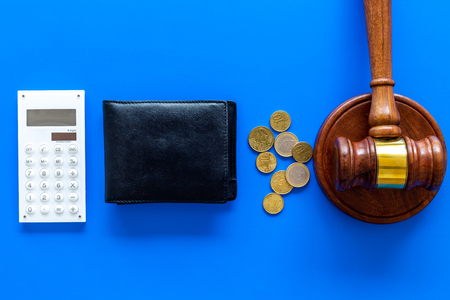 Financial failure, bankruptcy concept. personal bankruptcy. Judge gavel, wallet, coins, calculator on blue background top view