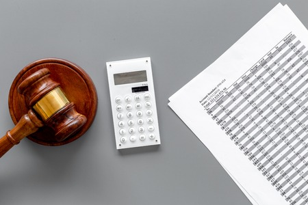 Declare bankruptcy concept. Start of bankruptcy procedure. Judge gavel, financial documents, calculator on grey background top view Фото со стока