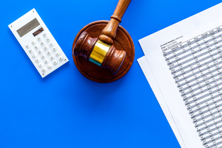 Declare bankruptcy concept. Judge gavel, financial documents, calculator on blue background top view copy space