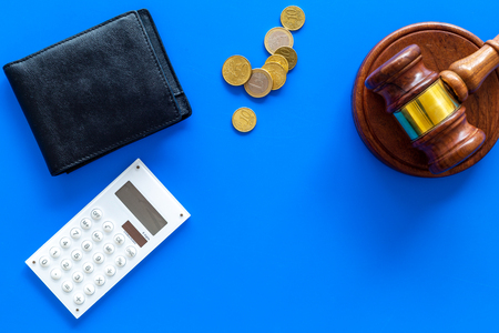 Financial failure, bankruptcy concept. Judge gavel, wallet, coins, calculator on blue background top view