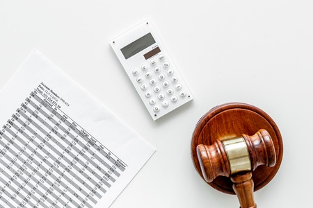 Declare bankruptcy concept. Judge gavel, financial documents, calculator on white background top view. Stock Photo