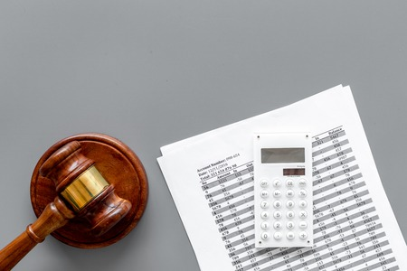Declare bankruptcy concept. Judge gavel, financial documents, calculator on grey background top view
