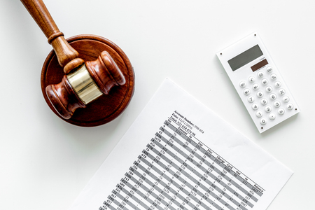 Declare bankruptcy concept. Judge gavel, financial documents, calculator on white background top view Stock Photo