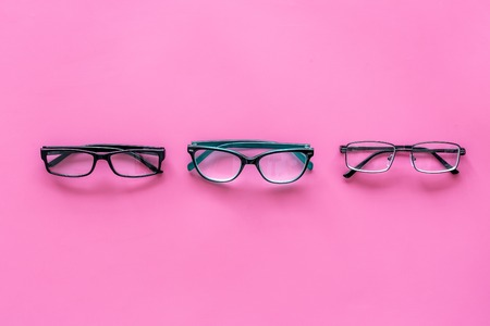 Glasses with transparent optical lenses on pink background top view. Stock Photo - 108110822